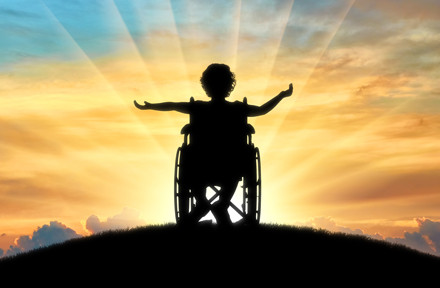 Silhouette of child in wheelchair