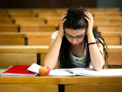Unhappy girl sitting exam