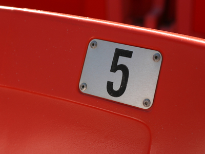 A number 5 on a red background