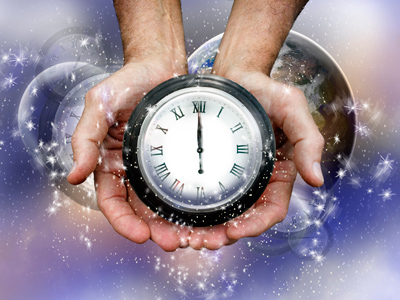 A pair of hands holding a clock.