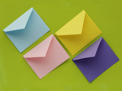 Four colorful envelopes on a green background