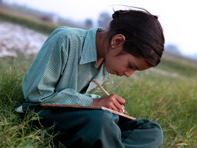 Child writing a story in their notebook