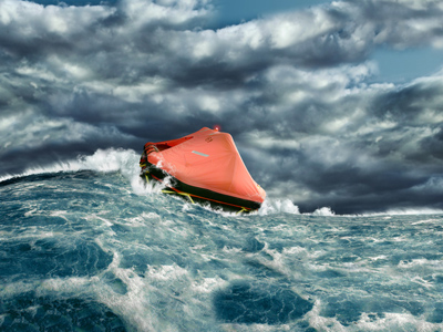 Life raft floating in stormy sea