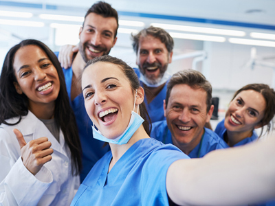 Group of dentists smiling at camera