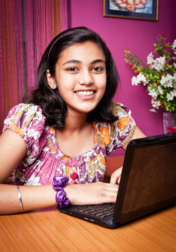 Education-Quizzes-Girl-Using-Laptop