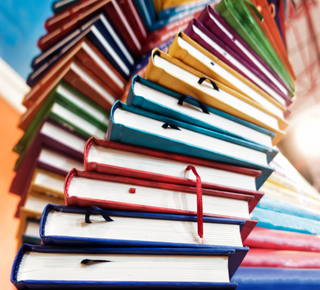 Stacks of colourful books to read