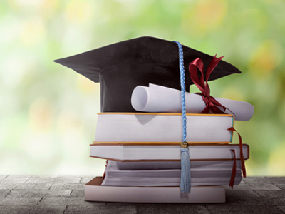 Symbols of education - mortarboard, textbooks and diploma