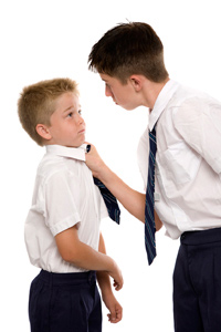 Older boy bullying younger one at school