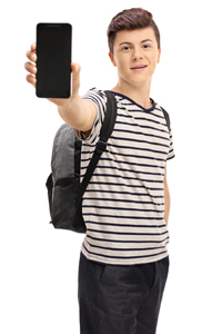 Teenage schoolboy holding iPad