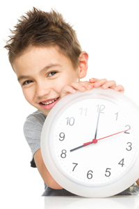 Young boy learning to tell the time