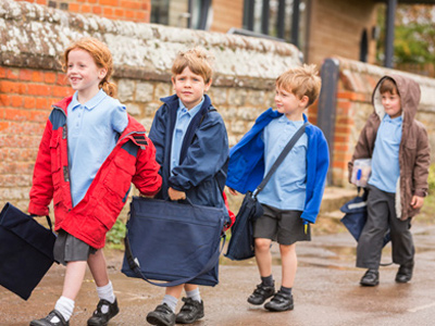 Young children on their way to primary school