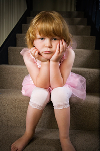 Young girl being disciplined by sitting on the naughty step