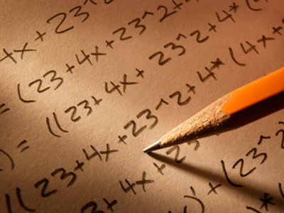 Pencil writing mathematical calculations on a piece of paper