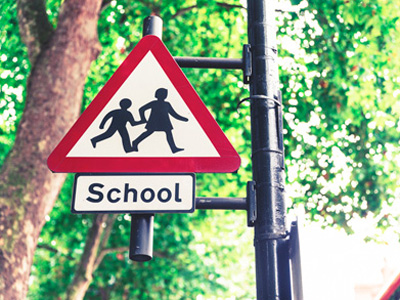 Road sign warning of children going to and from school
