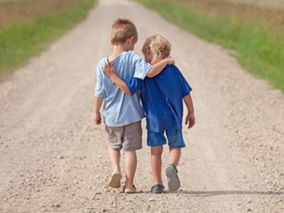 Autistic boy walking with his close friend