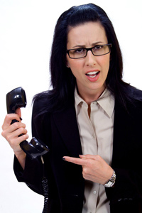 Woman annoyed with cold caller on her telephone