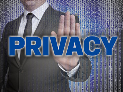 Businessman holding up his palm behind the word 'Privacy'