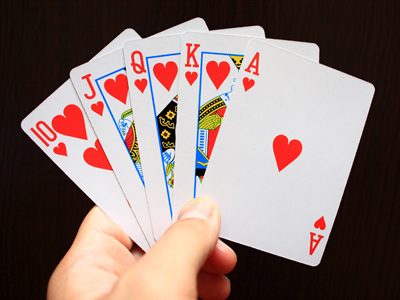 A royal-flush hand of cards