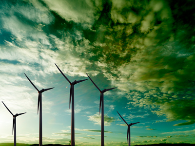 A wind farm against a dramatic sky