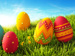 Colourful Easter eggs on grass.