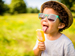 Boy in sunglasses licking an ice lolly