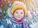 Young girl in woolly hat and scarf in snow