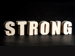 The word strong on a black background