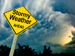 Cloudy sky with stormy weather roadsign