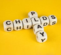 Letter cubes arranged to spell 'Childs Play'