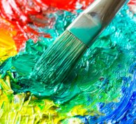 Art palette with colourful oil paints and brush