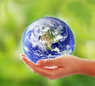 Hand holding a miniature globe of the world
