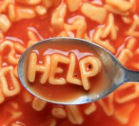 Alphabet soup that is spelling 'Help'